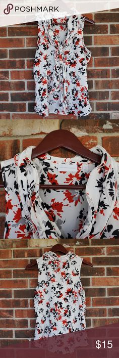 Floral Blouse New York & Co Like new condition. SZ XS. Cute tie/ bow in the front for extra flare. Fits very nicely. Very classy and sophisticated. Light material perfect for summer and spring.  Bundled discounts. Ships same or next day. Offers welcome. No lowballs New York & Company Tops Blouses