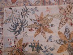 Soms zie je een quilt waar je helemaal weg van bent...     En dit is er zo eentje : de Eight Pointed Daisy Wreath Center Medallion quilt....