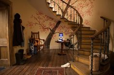 Traditional Entry with Paddington inspired mural -- Although the mural isn't in the original books, it adds something truly special to the movie. Whimsical and welcoming, the tree loses its flowers and fills with leaves and blooms during the movie as the dramatic events unfold.