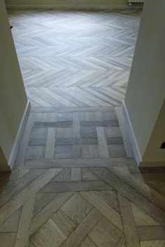 just love mosiac, inlay, wooden floors. great idea for trying to blend two different floor patterns
