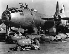 Ground crews arming a Boeing B-29 Superfortress of the 500th Bomb Group at Isley Field, Saipan, Mariana Islands, 1944-45