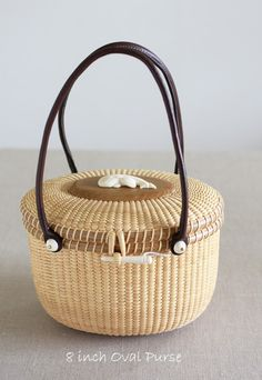 8 inch Oval Purse Base, Rim:  Oak Dome, Peg, Carving:  Ivory Handle:  ...