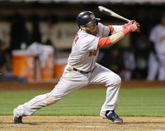 Boston Red Sox second baseman Dustin Pedroia swings for an RBI single against the Oakland Athletics in the seventh inning of a baseball game Monday, May 11, 2015, in Oakland, Calif. (AP Photo/Ben Margot)  Boston Red Sox Team Photos - ESPN