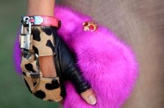 Fuzzy pink clutch with motorcycle leather gloves and Leopard print