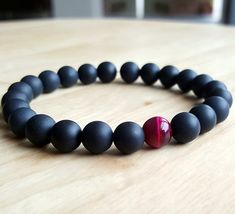 Check out this item in my Etsy shop https://www.etsy.com/listing/385276456/matte-black-onyx-bracelet-bracelets-rose