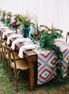 Stunning bohemian tablescape: http://www.stylemepretty.com/little-black-book-blog/2016/03/30/cozy-rustic-wedding-complete-with-giant-dream-catchers/ | Photography: Graham Terhune - http://www.grahamterhune.com/