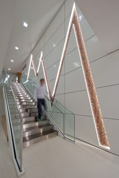 Certified Financial Planner Board of Standards, Inc.'s New Office:  Stairs run along a branding wall that represents a fluctuating stock market. The wall is composed of thousands of pennies set at different depths.