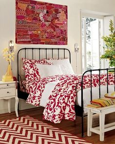 guest bedroom with red accents