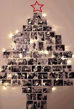 Hang photos on your wall in the shape of a Christmas tree along with lights around it.   How cute is this