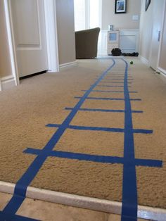 Use painter's tape or masking tape to make easily removable train tracks! Great for rentals or your own home.