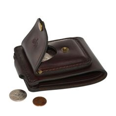 PRODUCT FEATURES: • Two large sections for cash • Three card slots • ID slot • Exterior coin pocket • Locking snap • Hand sewn with waxed thread OTHER COLORS AVAILABLE : TanBrownBlack