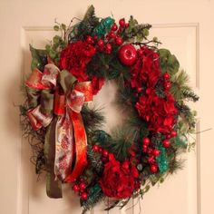 Silky Flower Store - Holiday Spirit Hydrangea Wreath, $59.00 (http://www.silkyflowerstore.com/christmas-wreaths/holiday-spirit-hydrangea-wreath/) Cheery design for office door or wall. Free shipping.