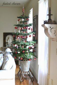 """Love how open and airy this tree is. Shows the ornaments off, reminds me of our trees from when we were kids. Which my kids call """"Charlie Brown"""" trees. Faded Charm: ~Holiday Home Tour cute tree in olive bucket Very Merry Christmas, Christmas Love, All Things Christmas, Christmas Holidays, Xmas, Christmas Crafts, Cottage Christmas, Primitive Christmas, Country Christmas"""