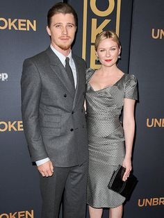 Star Tracks: Tuesday, December 16, 2014   SO UNITED   Also at the Unbroken premiere, actor Garrett Hedlund and girlfriend Kirsten Dunst, who make quite the coordinated couple on Monday night.