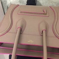 Oh my goodness! I love, love, love this Celine handbag. The nude trimmed in pink makes it perfect! ❤