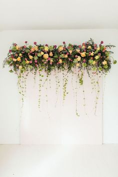 We added our Cascading Ivy Greenery and Bubble Gum Pink Billy Balls to add some depth to the backdrop. We simply removed the stems and inserted them evenly across the bottom. We actually still have our Pink Billy Balls. They will last forever. Diy Photo Booth Backdrop, Floral Backdrop, Wall Backdrops, Engagement Decorations, Backdrop Decorations, Wedding Decorations, Diy Your Wedding, Bridal Shower Flowers, Ceremony Backdrop