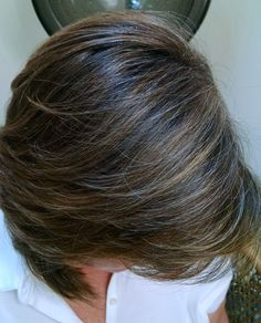 "This is a client of mine in her early sixty's. Instead of the monthly of all over color, ""Babylights"" of highlights and lowlights blends her grey and leaves her hair more multidimensional, radiant, and natural-looking. A great look for working professional women. ~ www.dmazsalon.com (216) 292-HAIR (4247)"