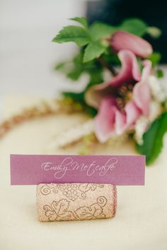 an old classic - wine corks used to hold seating cards  Photography by eonimages.com.au