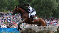Michael Jung of Germany and horse Sam negotiate a jump in the Eventing event at Greenwich Park on 30 July.
