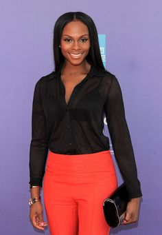 Tika Sumpter Button Down Shirt - Tika Sumpter wore a basic sheer black button-down with bright pants at the 2011 Tribeca Film Festival.