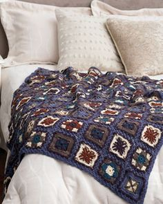 Several varied lacy granny square motifs combine in a stunning throw. Shown in Bernat Super Value.
