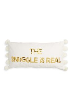 Can't wait to snuggle up next to this glamorous accent pillow trimmed with fluffy pompoms.