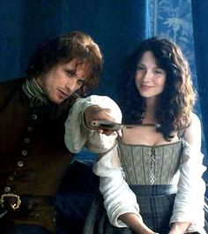 1b-112 ~ LALLYBROCH ~ Jamie showing Claire his father's sword that was still hidden under the bed.