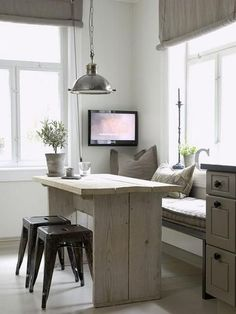 Cute & cosy space saver: window seat with rustic timber table and a pair of stools; there's even enough room left over for a telly :-)