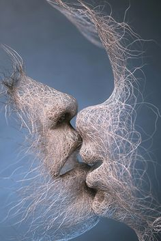 Adam Martinakis shows here the natural and perfect that could be a couple and a kiss. It's so perfect.