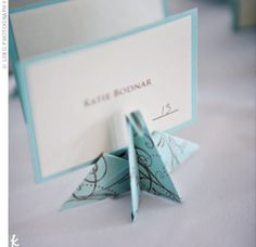 The Escort Cards    Ngoc's sister, cousin, and aunt helped her fold 140 paper crane escort cards. The flock of paper birds fit in perfectly with the wedding theme.