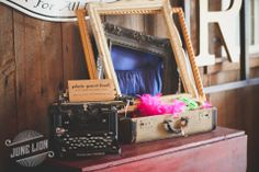 Poliroid guest book station. Vintage typewriter. Vintage suitcase. Picture frames. Fun hats. Barn wedding. Rustic wedding.