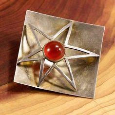 "Kultaseppä Salovaara, vintage ""Star"" brooch in sterling silver with red carnelian. #Finland   FinlandJewelry.com"