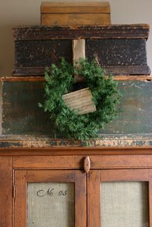 boxes, cabinet w/wreath...