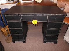 SOLD - Painted 9 drawer desk with rope detail on edges, painted black and distressed.***** In Booth G15 at Main Street Antique Mall 7260 E Main St (east of Power RD on MAIN STREET) Mesa Az 85207 **** Open 7 days a week 10:00AM-5:30PM **** Call for more information 480 924 1122 **** We Accept cash, debit, VISA, Mastercard, Discover or American Express
