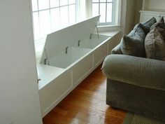 These remind me of the storage on a ship, and it's a window seat, put some cushions on it and your good to go.
