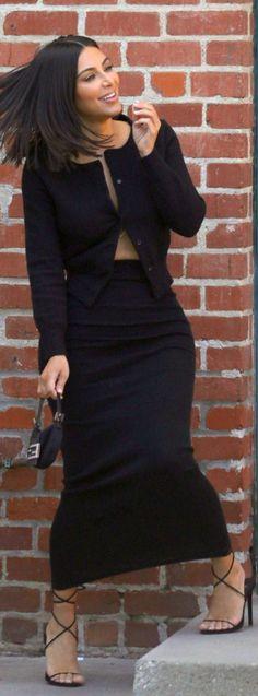 Who made Kim Kardashian's black maxi skirt, lace up sandals, cardigan sweater, and handbag?