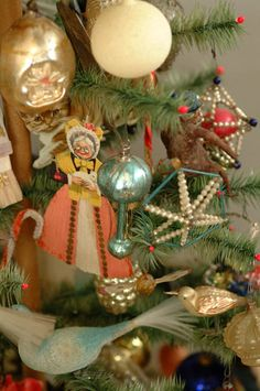 Antique glass ornaments, on a feather tree.
