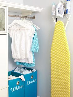 Part of any good DIY organization project is making sure oft-used items are in easy-access spots -- and that they stay that way. Helpful off-the-shelf products -- here, an ironing board hanger/organizer -- can help, as can baskets (divided by laundry type) and accessible storage for quickly hanging clean laundry.