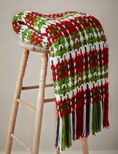 Yarnspirations.com - Caron Woven Plaid Blanket - Patterns  | Yarnspirations | Get cozy this holiday season with this woven plaid blanket crocheted in festive shades of Caron United.