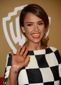 "Pin for Later: Jaime King Got an Elegant Rose Tattoo, Plus More Celebrity Ink Jessica Alba You can often spot Jessica's dainty Sanskrit wrist tattoo, which translates to ""lotus flower."""