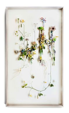 Flower Constructions by Anne ten Donkelaar, 3D collage of cutout flower prints and dried flowers. via Behance