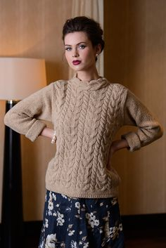 Luxury Aran Horseshoe Cable Sweater  This Aran Cable Sweater features the oversized cable pattern with a mock turtleneck for a classic feminine feel. Its luxurious cashmere and wool mix gives an extra feeling of softness to the wearer, making it a great choice for those that crave a little comfort from their clothing.