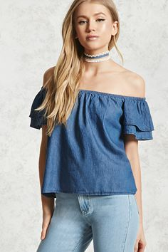 A chambray woven top featuring an elasticized off-the-shoulder neckline, short flounce sleeves, and a boxy silhouette.