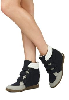 """Get the lift you love and the comfort you need. This versatile wedge sneaker is a cool-girl favorite for rock concerts and weekends of going with the flow.  Shoe Details Approx. Heel Height: 3"""" Approx. Platform Height: N/A Synthetic Upper Man Made So"""