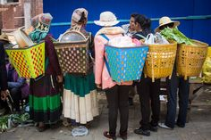 Women with baskets at Shaxi Friday Market -Shaxi Old Theatre Inn