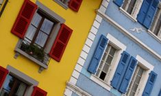 The outside of this apartment building is painted red, blue, and yellow, and it looks really cool. It also, happens to be a triadic color scheme.