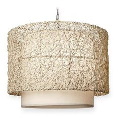 A loose organic weave of Nito creates a soft drum shape. The piece is finished with a natural linen drop shade.