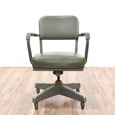 This swivel chair is featured in a shiny, polished gray steel. This mid-century modern style office chair has a seat with an adjustable height, quadrangular rolling wheel base, and gray vinyl upholstery. Perfect for a tanker desk! #midcenturymodern #chairs #swivelorofficechair #sandiegovintage #vintagefurniture