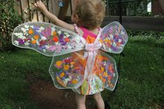 These butterfly wings are made using wire, clear contact paper, and flower petals.  What about making flower petal window hangings instead?  Same principle...just bend the wire into a circle, and hang the finished art in a window when done.