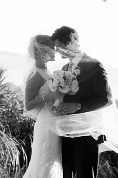 Sweetgrass Social wedding at Alhambra Hall. Erika & Sergio. Black and white picture of bride and groom under a vail.